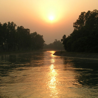 sunset over river - satpal singh flickr
