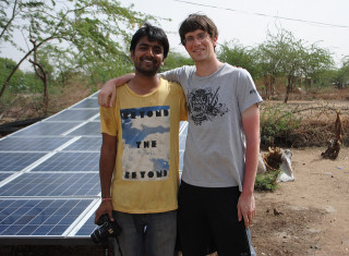 solar panel and smiling people - USAID flickr